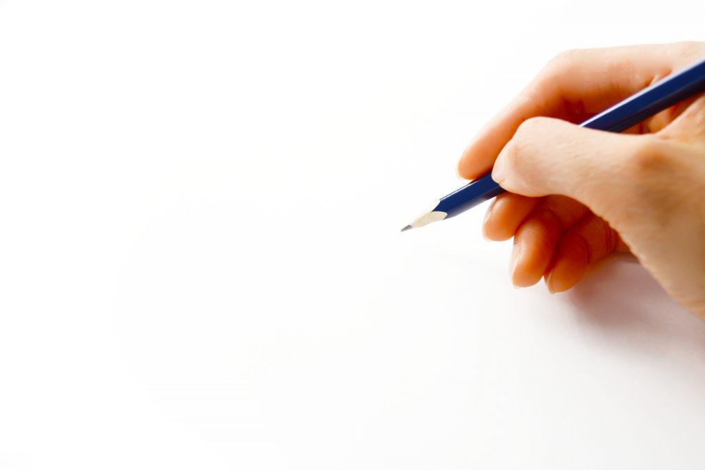 ペンを持つ手
